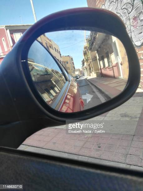 reflection on side-view mirror of car - nadal stock pictures, royalty-free photos & images
