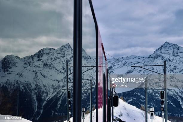 reflection on the glacier express - john laing stock pictures, royalty-free photos & images