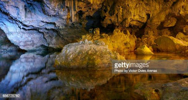 reflection on the underground lake of neptune's grotto near the town of alghero in sardinia, italy - victor ovies fotografías e imágenes de stock