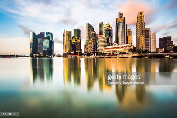Reflection with long exposure effect in the morning time at Singapore's Marina Bay landmark spot for tourists