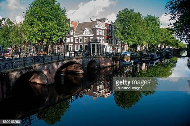 Reflections in a canal Amsterdam The Netherlands