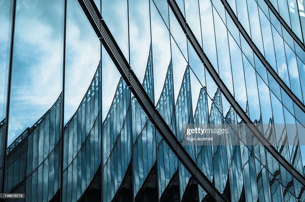 Reflections in a modern glass facade : Stock Photo