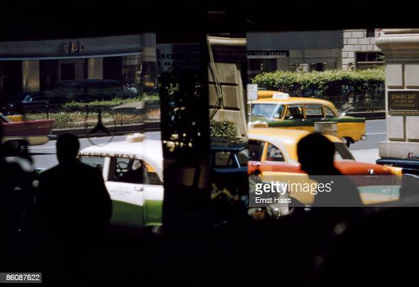 Reflections in a window on Park Avenue New York City circa 1980 The Drake Hotel is on the right on the corner of Park Avenue and 56th Street