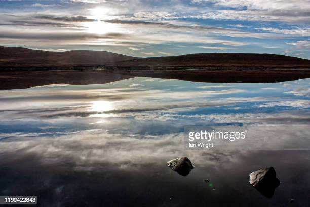 reflections in loch bad na h-achlaise near gairloch - moment of silence stock pictures, royalty-free photos & images