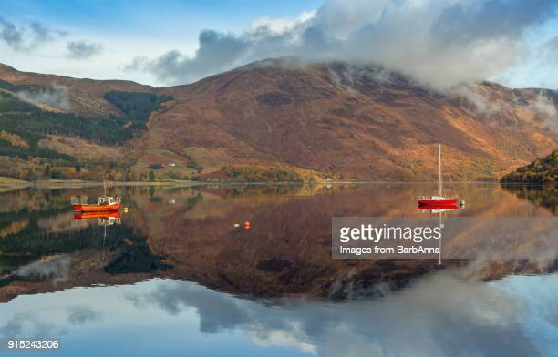 reflections in loch leven, glencoe, west highlands, scotland, uk - reflection lake stock photos and pictures