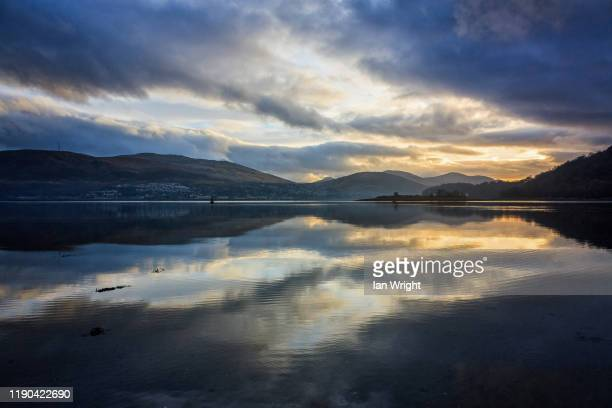 reflections in loch linnhe - moment of silence stock pictures, royalty-free photos & images