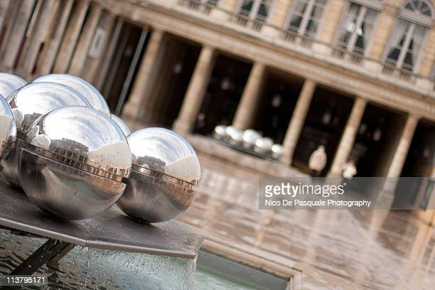 reflections in the palais royal fountain - palais royal stock pictures, royalty-free photos & images