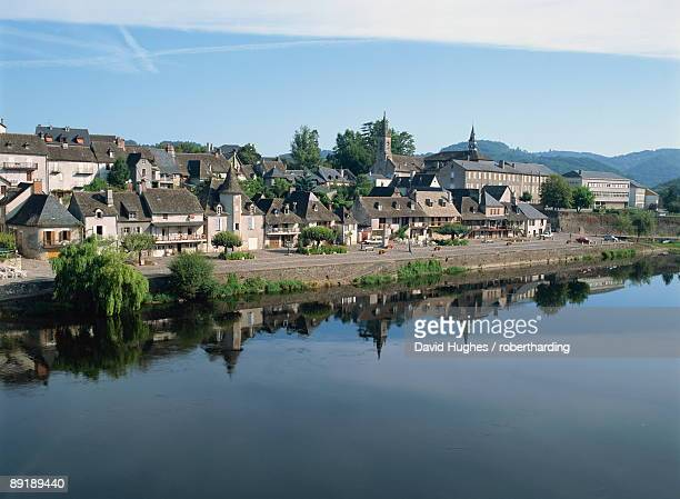 reflections in the river dordogne of houses and churches of argentat in correze, limousin, france, europe - correze stock pictures, royalty-free photos & images
