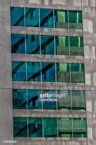 reflections in windows - distrito central stock pictures, royalty-free photos & images