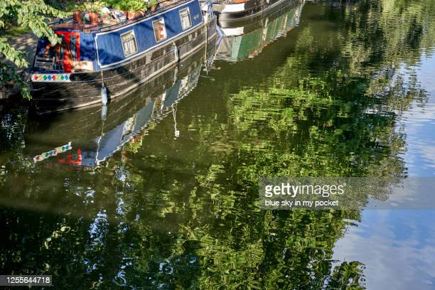 reflections of a narrow boat - east london stock pictures, royalty-free photos & images