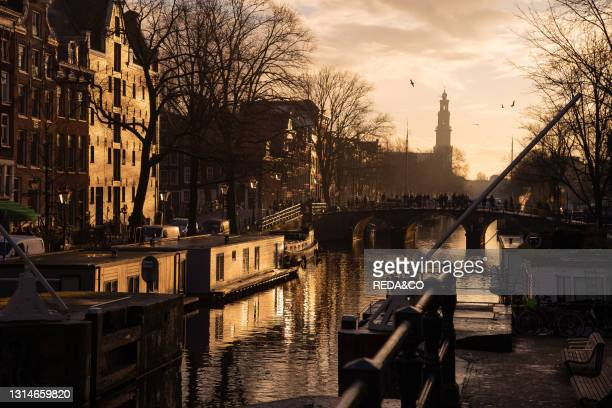 Reflections of Amsterdam's traditional buildinds on canals, Amsterdam, the Netherlands, Europe.