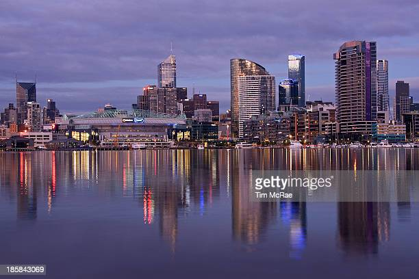 CONTENT] Reflections of blue and red Docklands at Melbourne early evening Includes Colonial / Telstra / Etihad Stadium and Rialto Building