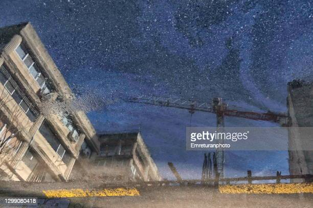 reflections of buildings and crane on a sunny day. - emreturanphoto stock pictures, royalty-free photos & images