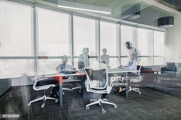Reflections of business colleagues having meeting in office