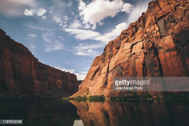 reflections of cliffs seen from the colorado river in arizona - rock formation stock pictures, royalty-free photos & images