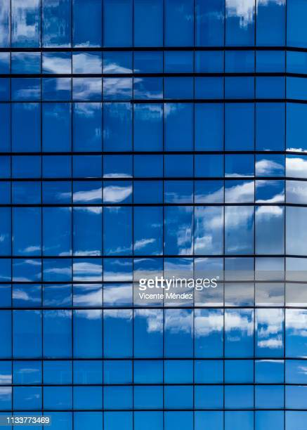 reflections of clouds in skyscrapers - moderno stock pictures, royalty-free photos & images
