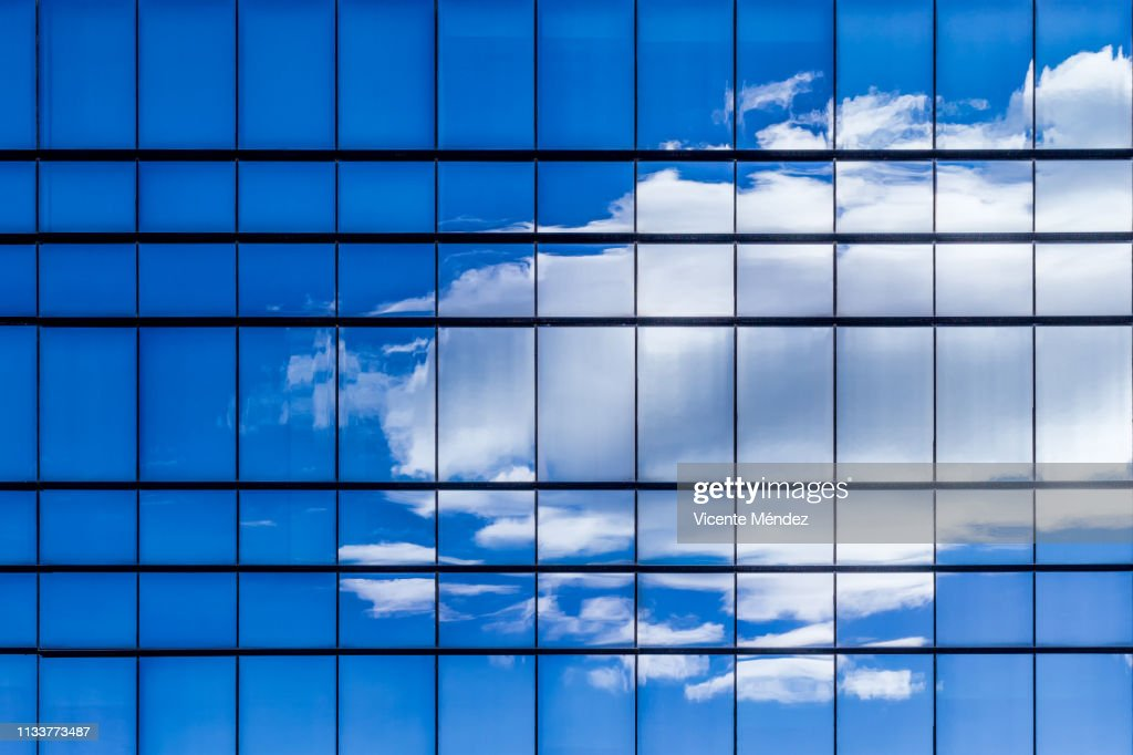 Reflections of clouds in skyscrapers : Stock Photo