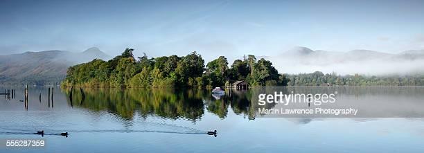 reflections of derwent isle in derwentwater - derwent water stock photos and pictures