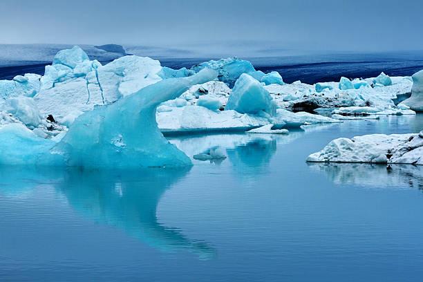 Reflections Of Icebergs At Jökulsárlón, Iceland Wall Art