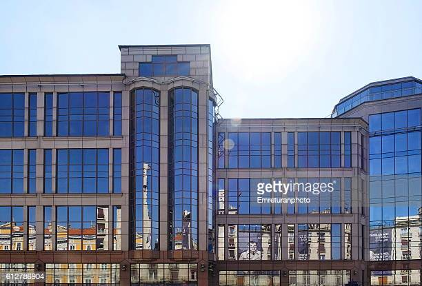 reflections of old buildings inside new - emreturanphoto stock pictures, royalty-free photos & images