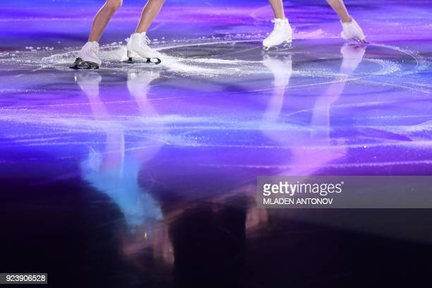 TOPSHOT Reflections of performers are seen on the ice during the figure skating gala event during the Pyeongchang 2018 Winter Olympic Games at the...