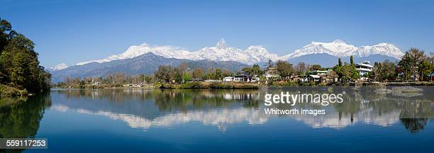 reflections of the annapurnas in fewa lake pokhara - machapuchare stock photos and pictures