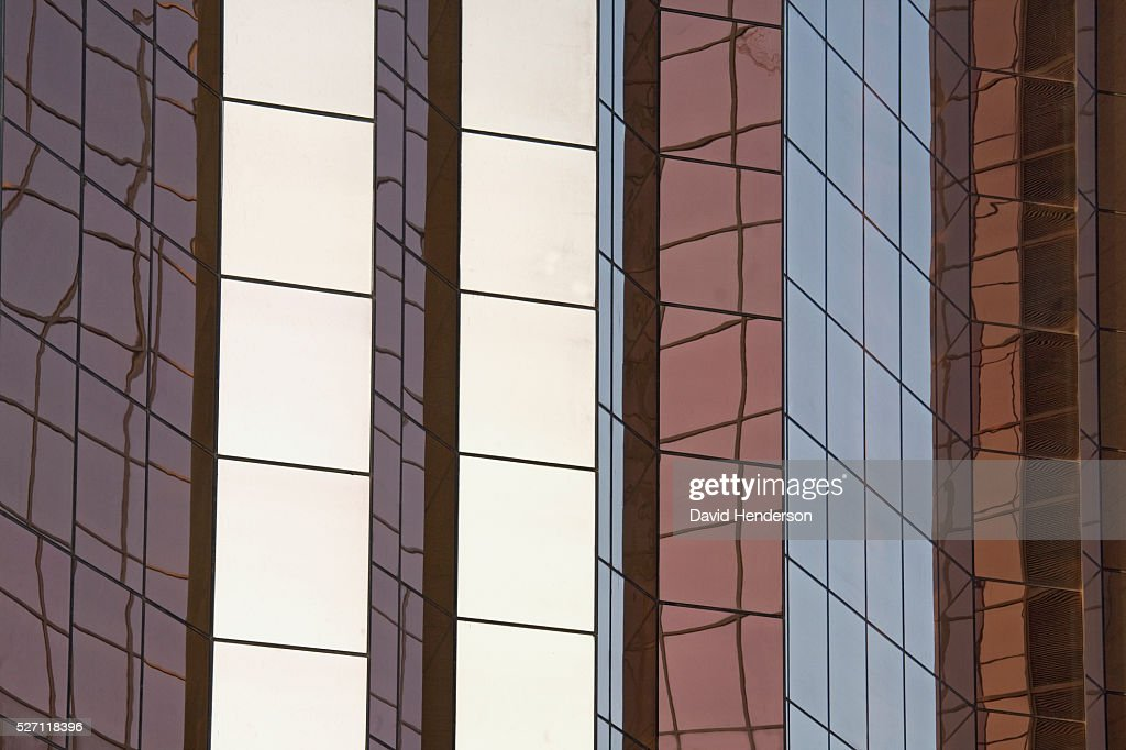 Reflections on a mirrored skyscraper : Stock Photo