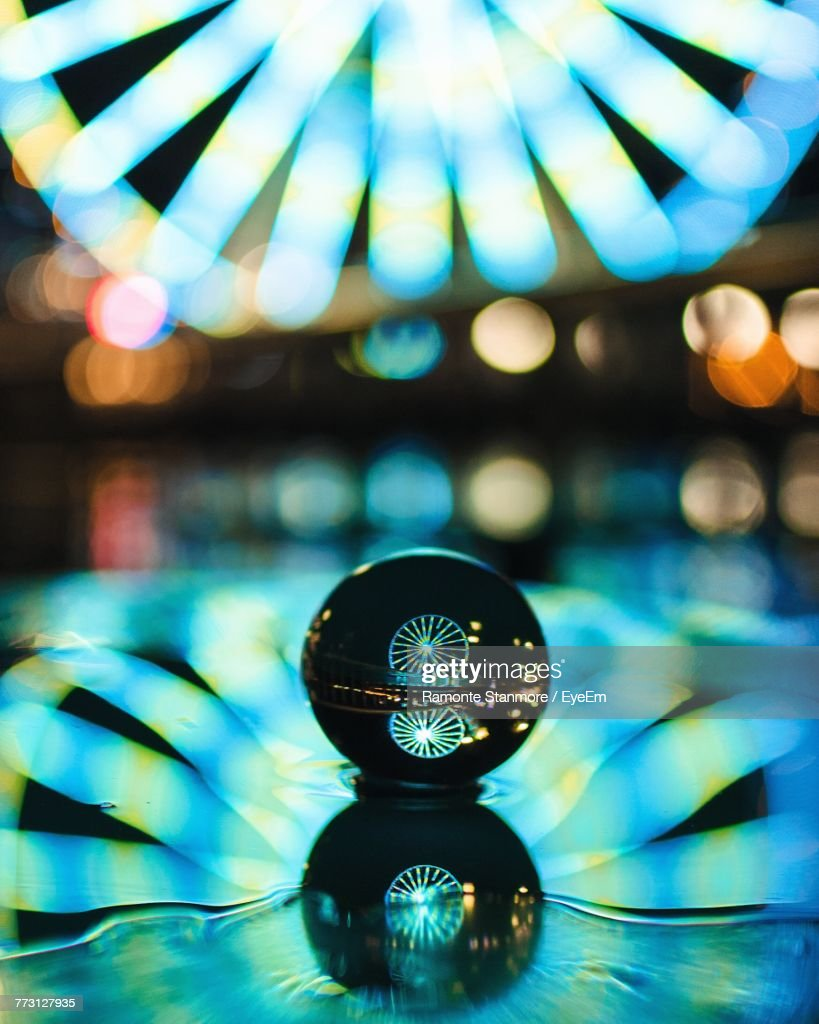Reflections On Crystal Ball At Night : Photo