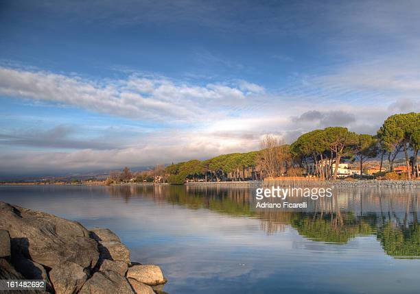 reflections on lake bolsena - adriano ficarelli stock-fotos und bilder