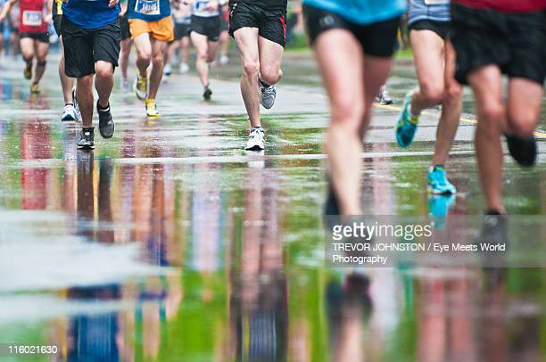 reflections on rainy marathon - marathon stock pictures, royalty-free photos & images