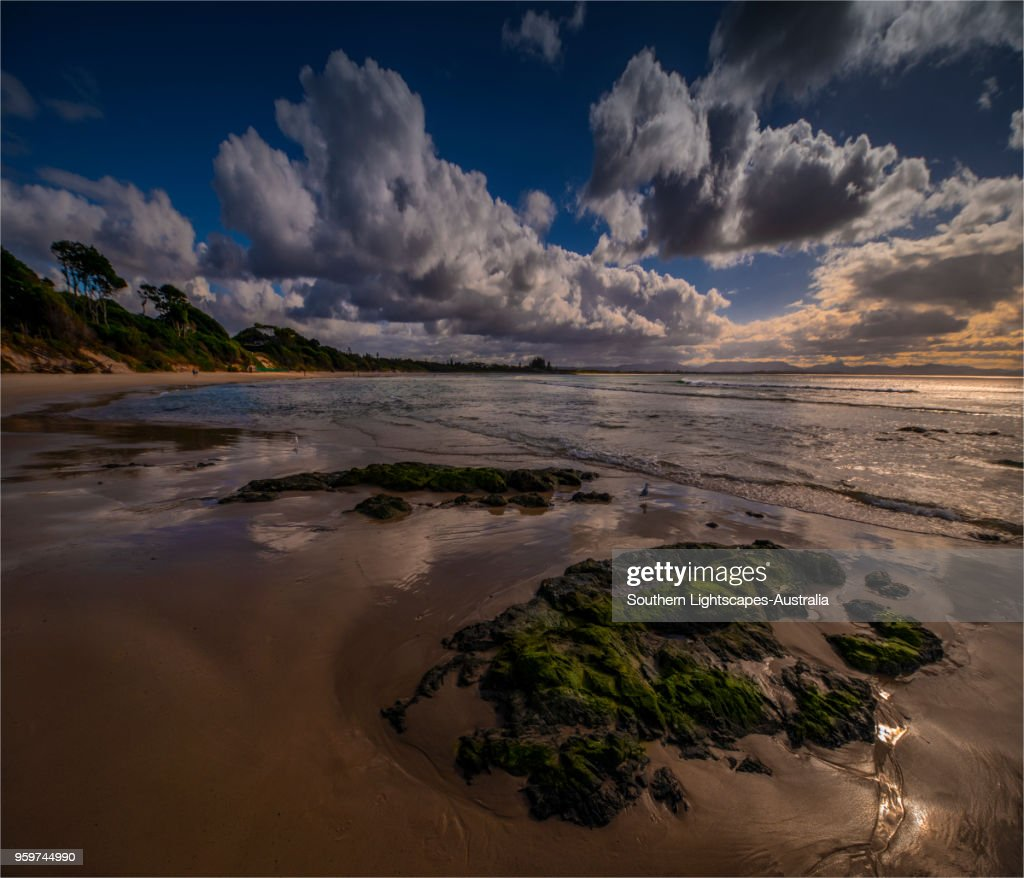 Reflections on the beach at low-tide, Byron Bay, New south Wales, Australia. : Stock-Foto