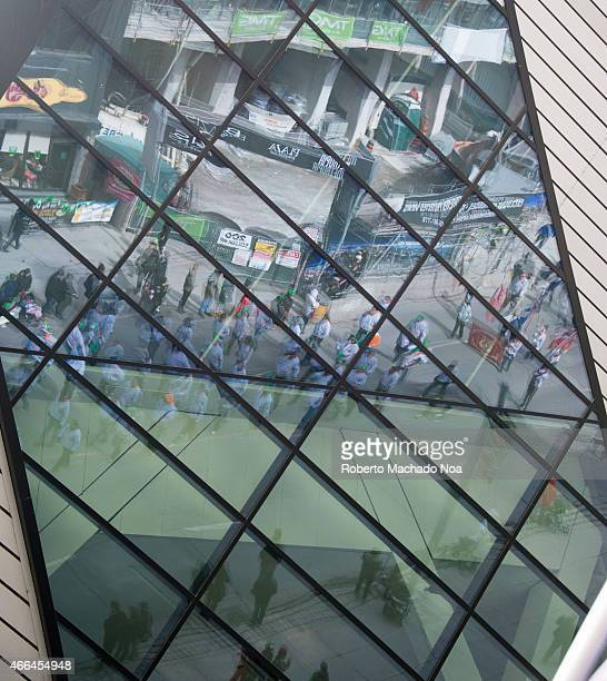 STREET TORONTO ONTARIO CANADA Reflections on the glass of the Ontario Royal Museum during the St Patrick's Day Parade 28th edition which is the...