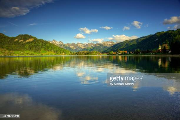 reflections on the lake sihlsee - schwyz stock pictures, royalty-free photos & images
