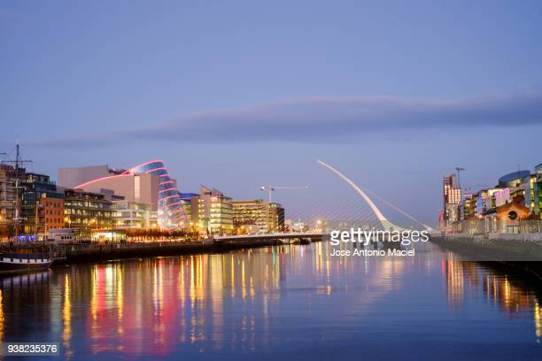 reflections on the liffey river in dublin - dublin stock pictures, royalty-free photos & images