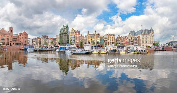 reflections on water in amsterdam, netherlands - dutch culture stock photos and pictures