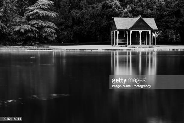 reflections - battersea park stock photos and pictures