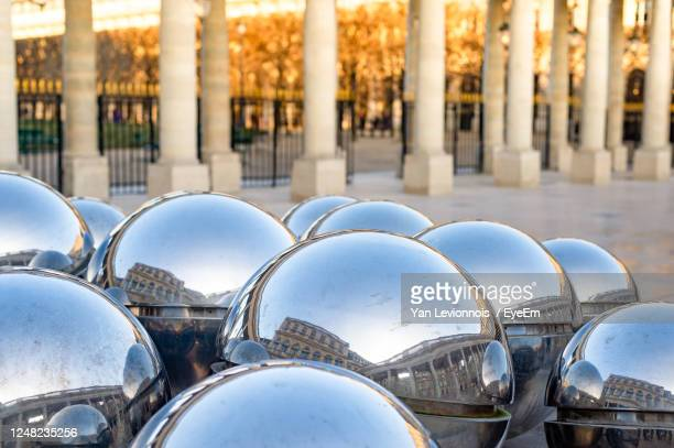 reflective bubbles - palais royal stock pictures, royalty-free photos & images