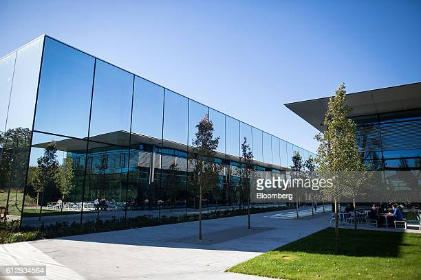 Reflective glass buildings sit on the Dyson Ltd campus in Malmesbury UK on Wednesday Oct 5 2016 In addition to cordless cleaning products the...