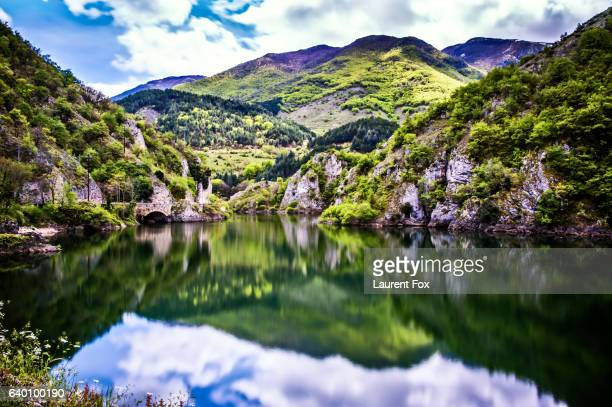A reflective lake in the Abruzzo National Park located in Aquila province in central Italy.
