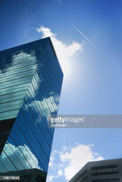 reflective skyscraper with sky and sun behind building - norfolk virginia stock photos and pictures