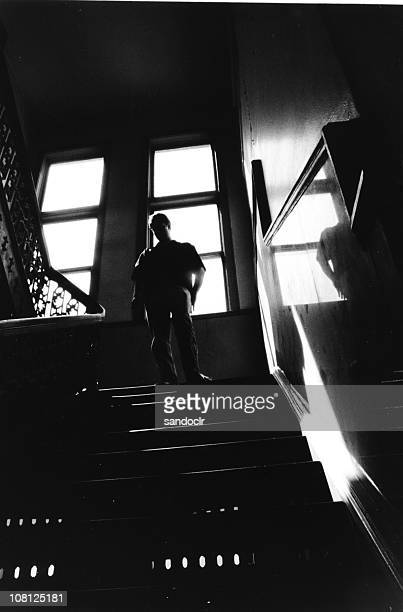reflective staircase - film noir style stock pictures, royalty-free photos & images