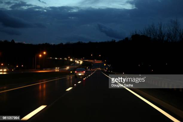 reflective stripes along the highway at night - detour sign stock photos and pictures