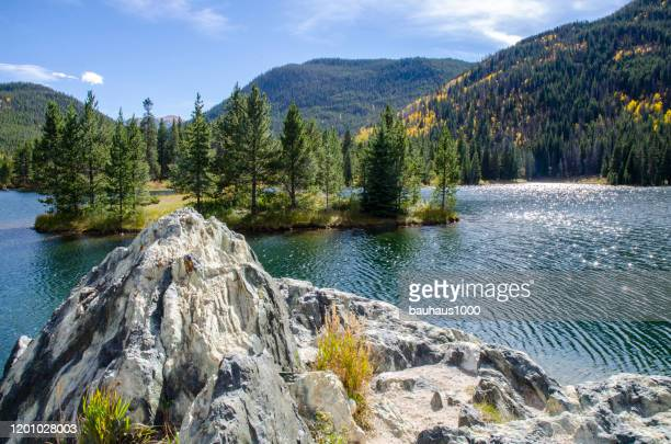 reflective waters of a pristine lake, officer's gulch in the colorado rocky mountains - rocky mountains north america stock pictures, royalty-free photos & images