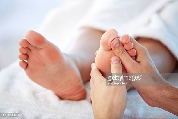 reflexology - male feet stock photos and pictures