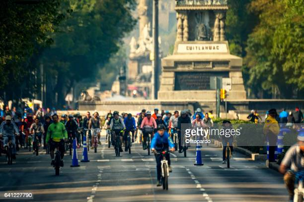 Reforma avenue in Mexico city and people in bicycles