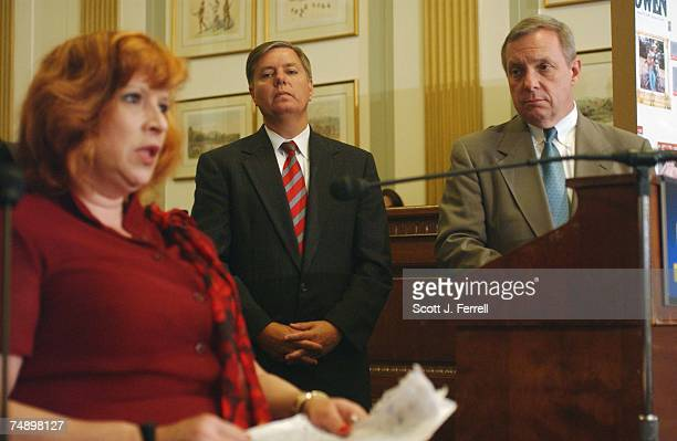 REFORMAs Sen Lindsey Graham RSC and Sen Richard J Durbin DIll look on Sherry Keller of Conyers Ga speaks during a news conference on the DurbinGraham...
