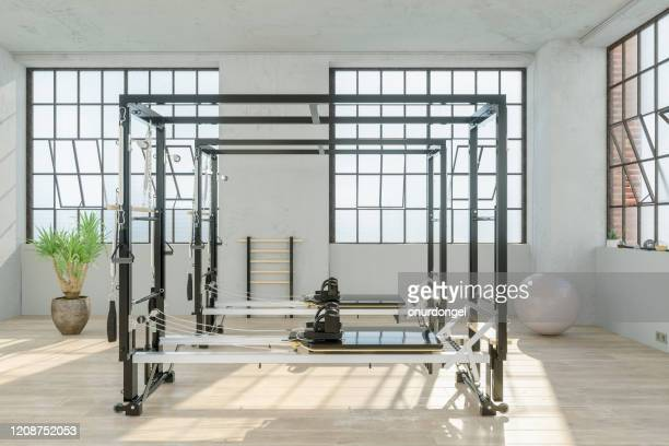 reformer in gym - yoga studio stock pictures, royalty-free photos & images