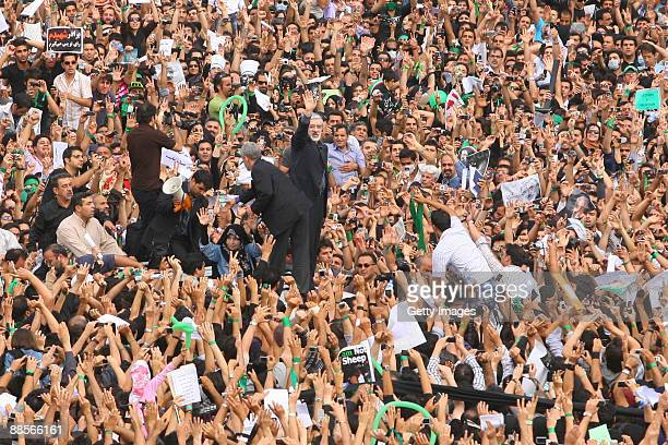 Reformist presidential candidate Mir Hossein Mousavi speaks to the crowd during a demonstration in the streets on June 18 2009 in Tehran Iran...