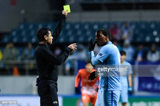 Refree Alireza Faghani shows a yellow card to Roger Martinez of Jiangsu Suning during 2017 AFC Asian Champions League group match between Jeju United...