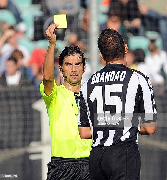 Refree Danilo Giannoccaro shows the yellow card to Goncalo Jardim Brandao AC Siena during the serie A match between AC Siena and AS Livorno Calcio at...